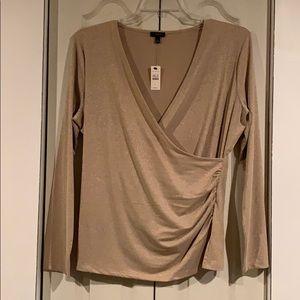 Women's long sleeve metallic gold blouse.